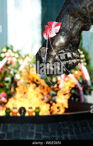 Warsaw Poland - Thursday 1st August - Detail on the Warsaw Uprising monument in Warsaw showing a resistance fighter holding a hand grenade with memorial flowers and flames behind as Poland commemorates the 75th Anniversary of the Warsaw Uprising ( Powstanie Warszawskie ) against the occupying German Army on 1st August 1944 - the Warsaw Uprising resistance fighters of the Home Army ( Armia Krajowa  - AK ) struggled on for 63 days against the Nazi forces before capitulation as the advancing Soviet Army waited across the nearby River Vistula. Photo Steven May / Alamy Live News - Stock Photo