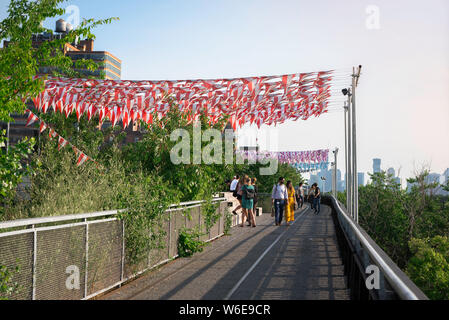 Chelsea High Line, view of people on a summer evening walking the High Line park in the Chelsea neighborhood of Manhattan, New York City, USA.