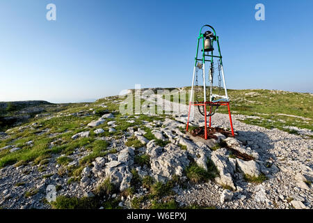 The bell on the top of Mount Ortigara remembers the bloody battles of the Great War. Asiago plateau, Vicenza province, Veneto, Italy, Europe. - Stock Photo