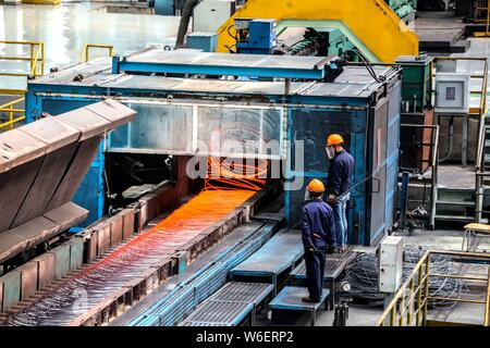 --FILE--Chinese workers survey the production of steel at a plant of Qingdao Special Iron and Steel Co., Ltd. in Qingdao city, east China's Shandong p