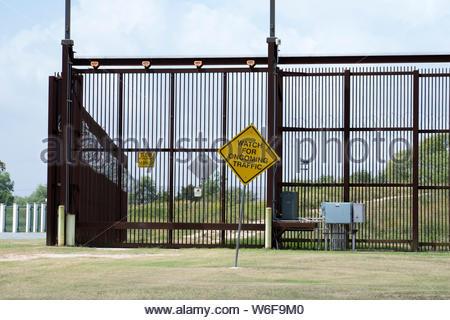 International Border. National Border. US Mexico Border Fence or Border Wall in Brownsville, Texas USA. Global Political Confrontation. USA Mexico - Stock Photo