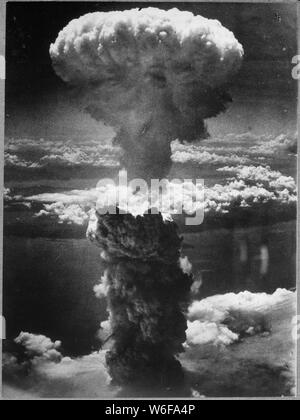 Atomic Cloud Rises Over Nagasaki, Japan; Scope and content:  Original caption: A dense column of smoke rises more than 60,000 feet into the air over the Japanese port of Nagasaki, the result of an atomic bomb, the second ever used in warfare, dropped on the industrial center August 8, 1945, from a U.S. B-29 Superfortress. General notes:  Atomic Cloud Rises Over Nagasaki (Q55437339) - Stock Photo
