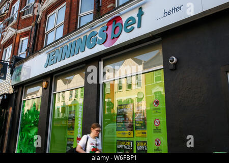 London, UK. 1st Aug, 2019. A woman walks past a JenningsBet Bookmakers branch in London. Credit: Dinendra Haria/SOPA Images/ZUMA Wire/Alamy Live News - Stock Photo
