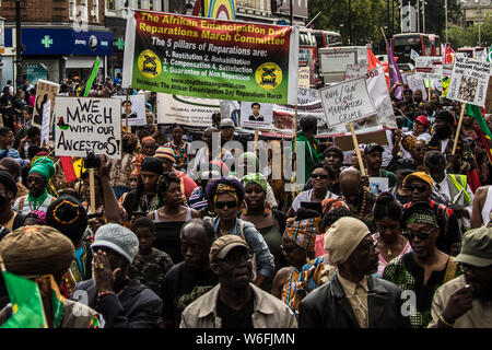 London, UK. 1st Aug, 2019. Hundreds of protesters marched from Windrush Square in Brixton to Parliament Square to demand slavery reparations. Credit: David Rowe/Alamy Live News - Stock Photo