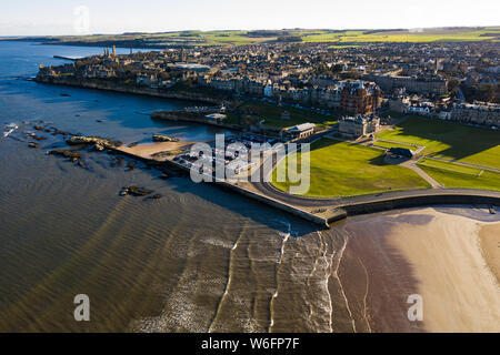 Aerial view of St Andrews from West Sands. The rocky coastline and the old course of St Andrews can both be ween in this stunning photo. - Stock Photo