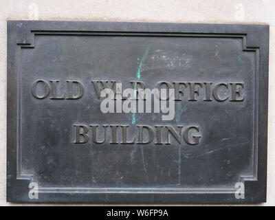 The sign on the façade of the Old War Office Building on Whitehall street in Westminster, London, reminds us of the past of a renovated building - Stock Photo