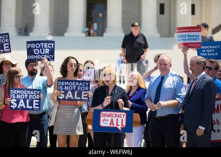 U.S. Senator Kyrsten Sinema of Arizona addresses a rally outside the Supreme Court building to support the 'Democracy for All' amendment July 30, 2019 in Washington, D.C. The amendment would prevent corporations from having the same free speech rights as individual citizens. - Stock Photo