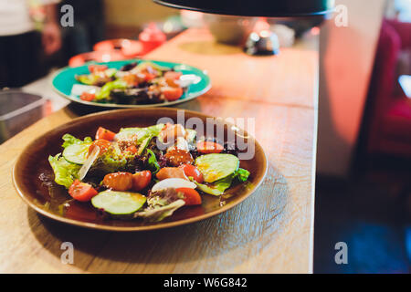 Buddha bowl of vegetable salad with baked falafel and avocado. Vegan Healthy Food Concept. - Stock Photo