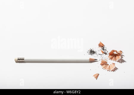 White Pencil with sharpening shavings on white background. Back to school concept. Copy space for text - Stock Photo