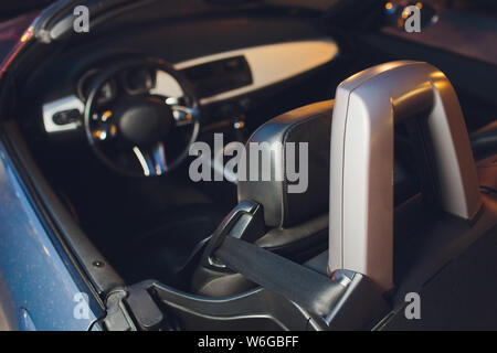 Convertible car's system with soft top closing opening. - Stock Photo