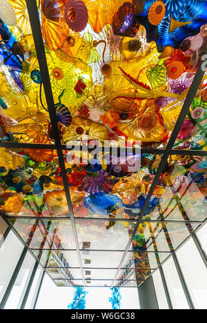 Colorful glass sculptures in glass ceiling on the Bridge of Glass in Tacoma, Washington. - Stock Photo