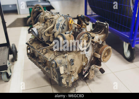 an old outdated engine, a closeup shot, engine car broken. - Stock Photo