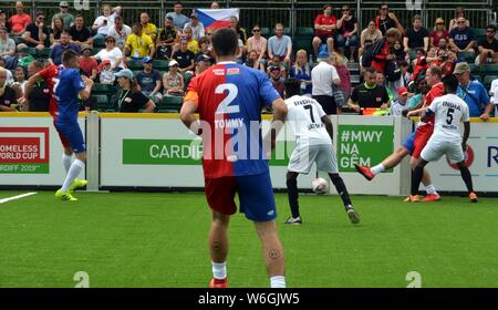 Players from India and the Czech republic compete for the ball at the Homeless football world cup in Cardiff in 2019. - Stock Photo