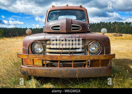 Old rusted pickup truck in field; Colorado, United States of America Stock Photo