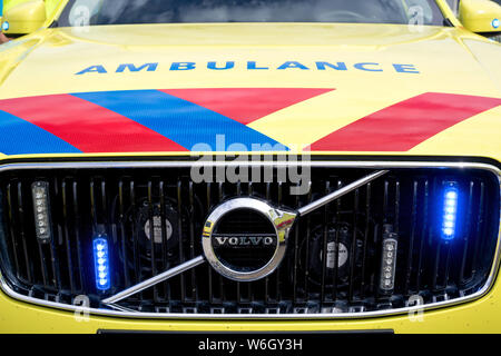 Dutch ambulance Volvo XC90 with active blue emergency lighting - Stock Photo