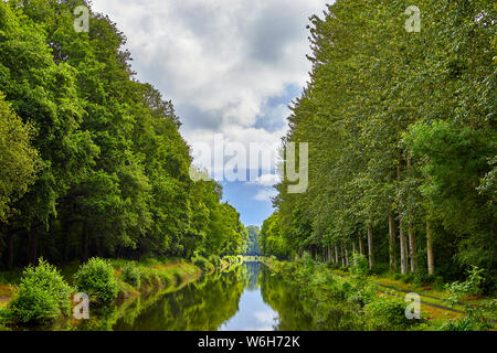 Image of the Canal d'Ille et Rance, River in Brittany, France with trees and the sky reflecting in the river/canal. - Stock Photo