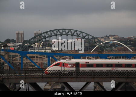 Newcastle upon Tyne, UK. 1st Aug, 2019. AZUMA LNER Flying Scotsman passenger train service crossing the King Edward Bridge over the river Tyne, Credit: DavidWhinham/Alamy Credit: David Whinham/Alamy Live News - Stock Photo