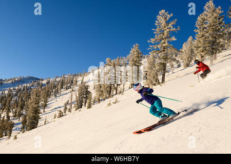 Skiing and snowboarding at Mt. Rose Ski Tahoe with fresh snow and Lake Tahoe views. - Stock Photo