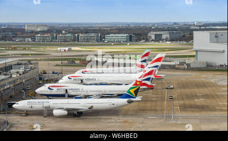 LONDON HEATHROW AIRPORT - MARCH 2019: Aerial view of jets operated by British Airways and South African in the maintenance area at London Heathrow. - Stock Photo