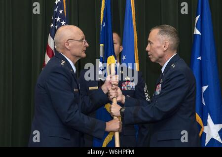 Maj. Gen. Tom Wilcox receives the unit flag from Gen. Arnold W. Bunch Jr. commander of Air Force Materiel Command, to become commander of the Air Force Installation and Mission Support Center July 25 during a ceremony at Joint Base San Antonio-Lackland, July 25, 2019. (U.S. Air Force photo by Johnny Saldivar). () - Stock Photo