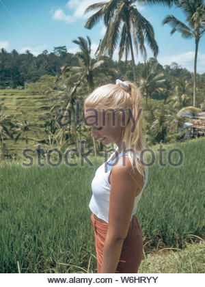 Young woman in tropical countryside - Stock Photo
