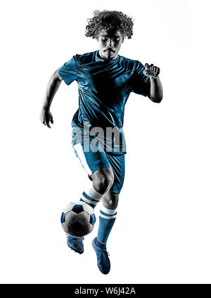 one mixed race young teenager soccer player man playing  in silhouette isolated on white background - Stock Photo