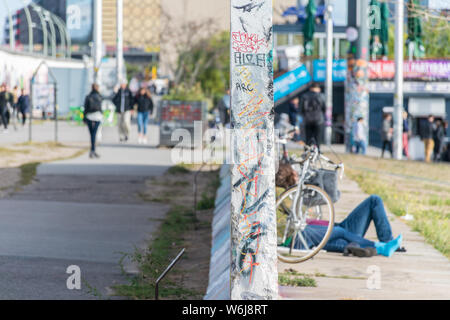 BERLIN, GERMANY - September 26, 2018: Sagacious perspective of a Wall division near the Banks of the Spree River and the Berlin Wall, a famous symbol - Stock Photo