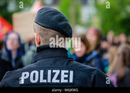 Police officer in action, Fridays for Future Demonstration, Essen, Ruhr Area, North Rhine-Westphalia, Germany - Stock Photo