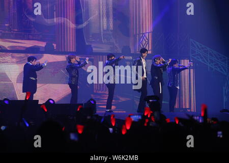 Members of South Korean boy band Super Junior perform during the