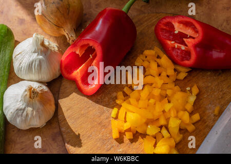 Sliced peppers and other vegetables. Garlic, onion and cucumber