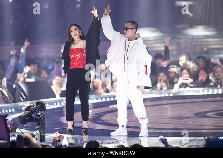 FILE--Chinese rapper Gai, right, performs with Hong Kong