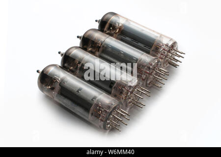 Set of four guitar amplifier power tubes on white background - Stock Photo