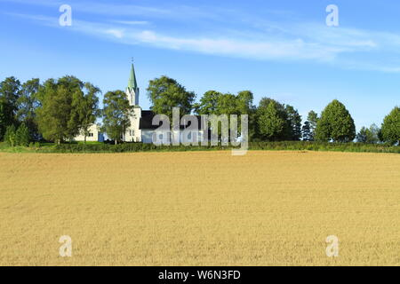 Church on wheat field - Stock Photo