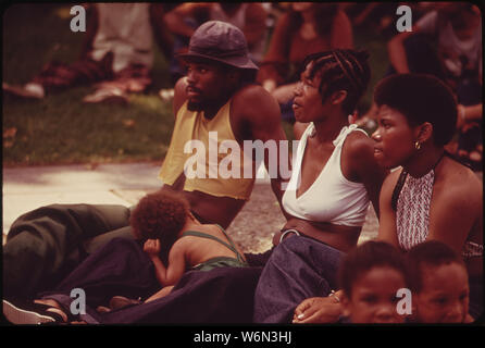 WEST VIRGINIA CELEBRATED ITS 110TH BIRTHDAY IN 1973 WITH ROCK CONCERTS ON THE STEPS OF THE STATE CAPITOL. WEST VIRGINIANS TOOK NOTE OF THE HOLIDAY BY PICNICKING ON THE CAPITOL GROUNDS, DANCING AND LISTENING TO THE MUSIC - Stock Photo