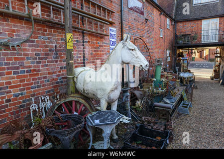Vintage white horse and garden ornaments in an antique shop in Hungerford, a historic market town in Berkshire, England