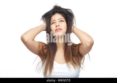 Woman pulling her hair - Stock Photo
