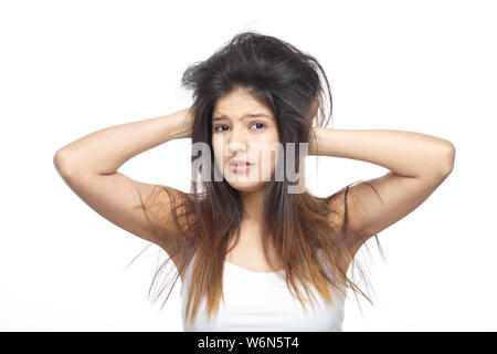 Portrait of a woman pulling her hair - Stock Photo
