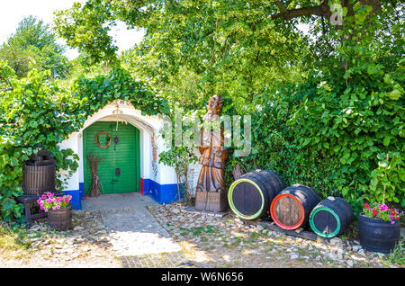 Petrov-Plze, Czech Republic - August 14 2014: Typical wine cellars in Moravia decorated with traditional slavic wine motives. Moravia wine region, tourism. Traditional buildings. Wine barrels. - Stock Photo