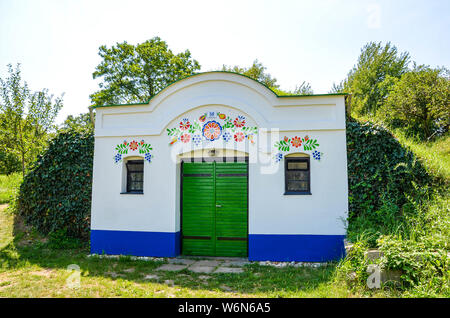 Petrov-Plze, Czech Republic - August 14 2014: Typical wine cellars in Moravia decorated with traditional slavic wine motives. Moravia wine region, tourism. Traditional buildings. - Stock Photo