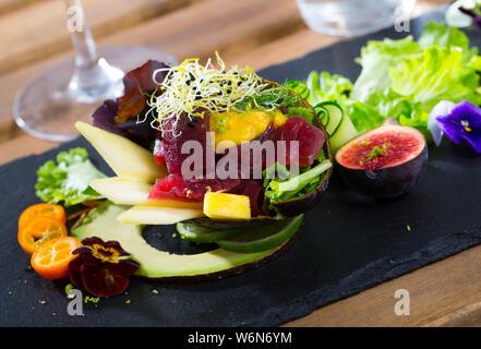 Image of  deliciously salad of raw tuna with  avocado, mango and greens - Stock Photo
