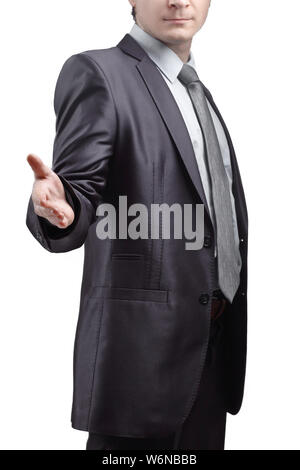 close up. the businessman extends his hand for greeting .isolated on grey background. - Stock Photo