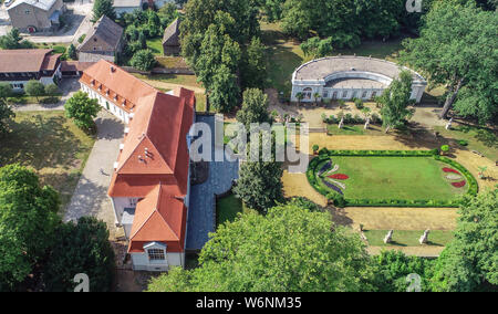01 August 2019, Brandenburg, Wiepersdorf: Wiepersdorf Castle with its park and orangery (aerial view with a drone). Since 01.08.2019 the castle has been under the sponsorship of the state of Brandenburg. The German Foundation for Monument Conservation has handed over the land and the buildings including the inventory of Wiepersdorf Castle to the newly founded Cultural Foundation. The state provides around 720,000 euros annually for the operation. According to the information provided, the reopening of the house and the arrival of the first scholarship holders in 2020 will be prepared. Photo: P - Stock Photo