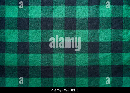 Fabric in a cage. Black and green square pattern. Clothes Empty Background - Stock Photo