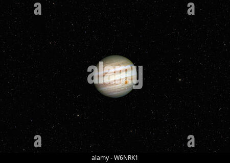 Planet Jupiter against dark starry sky background in Solar System, elements of this image furnished by NASA - Stock Photo