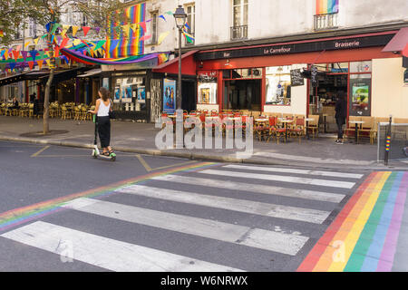 Paris street scene - scene on Rue des Archives, permanently coloured in rainbow symbols in the Marais district, Paris, France, Europe. - Stock Photo
