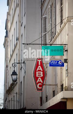 Paris 6th arrondissement, Rue Dauphine, symbol of a carotte for a tobacco shop - Stock Photo