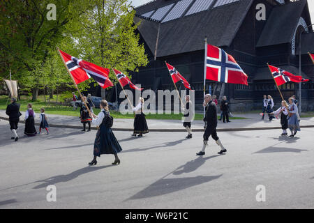 Norwegian patriots holding national flags during the yearly Norways' independence day events near Skansen park's entrance. Scandinavia, Sweden - Stock Photo