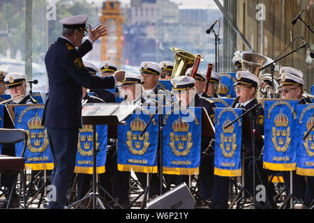 Stockholm's police musicians and conductor performing live on stage. Annual celebrations of the national Norwegian independence day. Skansen.Sweden - Stock Photo