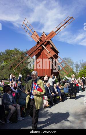 Skandinavian crowds gathering in Skansen's Olandskvarnarna site spot,  during the Norwegian national independence day celebrations. Sweden - Stock Photo