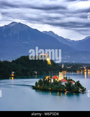 my journey to bled, seen from the top of a forest where you can see the church immersed in the lake - Stock Photo